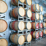 Oak barrels for fermenting the wine at Summit Estate Winery in Stanthorpe, Queensland