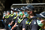 Large numbers of police are seen during the Melbourne Freedom Rally at Parliament House. Police move into position on the steps of state parliament ahead of a planed protest. The groups who have organised the many Freedom Day protests over the last 3 months, attempted to march on State Parliament during Melbourne Cup Day demanding the sacking of Premier Daniel Andrews for the lockdown and attacks on their civil liberties. Police met with the protester's with significant force despite the city having had zero cases for five days. (Photo by Dave Hewison/Speed Media)