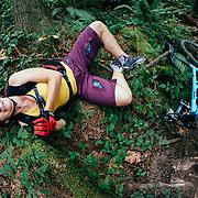 Heather Goodrich heads over the bars in the Pacific Northwest Rainforest near Anacortes, Washington.