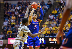 Jan 19, 2019; Morgantown, WV, USA; Kansas Jayhawks guard Quentin Grimes (5) shoots a three pointer during the first half against the West Virginia Mountaineers at WVU Coliseum. Mandatory Credit: Ben Queen-USA TODAY Sports