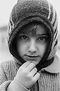 Portrait of a child refugee from Bosnia at the Varazdin refugee camp in Croatia in the winter of 1992.