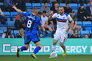 Ryan McLaughlin takes on his man during the EFL Sky Bet League 1 match between Gillingham and Rochdale at the MEMS Priestfield Stadium, Gillingham, England on 30 March 2019.