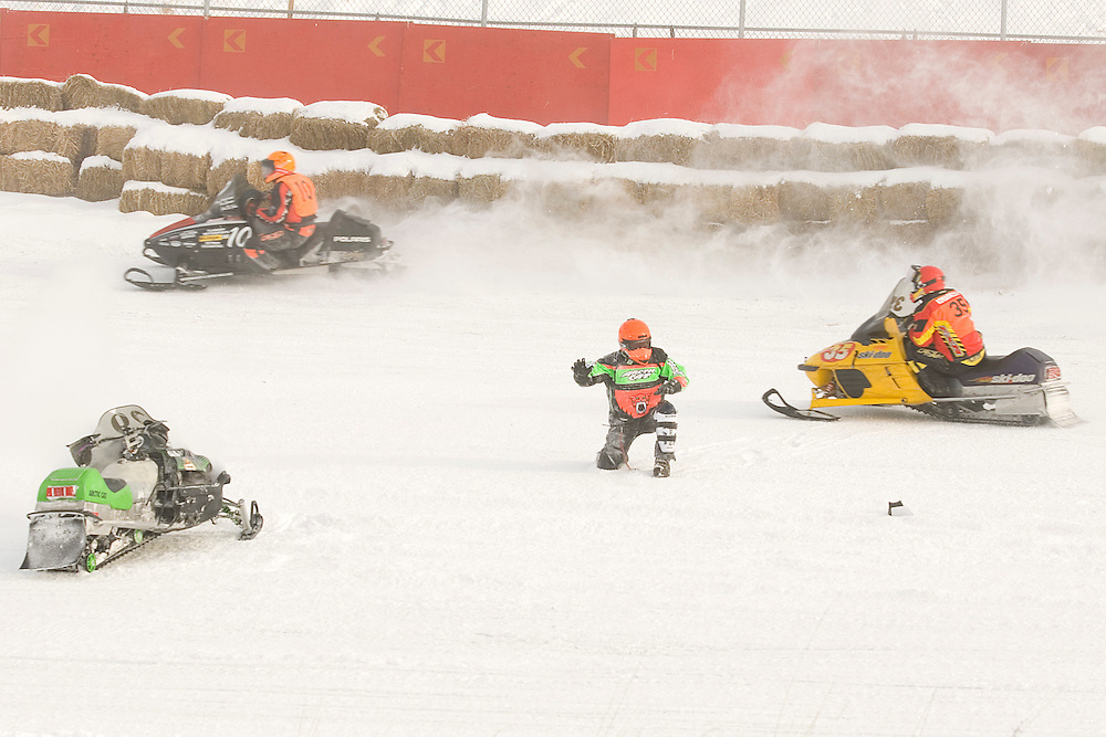 Snowmobile racing action at the I-500 Snowmobile race in Sault Ste. Marie Michigan.