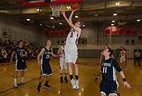 Belmont's Tom Pare goes up for a shot during NHIAA Division III second round tournament action with St. Thomas Aquinas Thursday evening.  (Karen Bobotas/for the Laconia Daily Sun)
