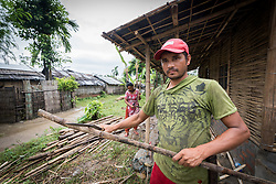 14 September 2018, Damak, Nepal:  A man and a woman carve sticks by their home in the Beldangi refugee camp. Supported by the Lutheran World Federation, the Beldangi refugee camp in the Jhapa district of Nepal hosts more than 5,000 Bhutanese refugees.