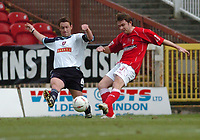 Photo. Leigh Quinnell.  Swindon Town v Walsall Coca Cola league one. 09/04/2005. Swindons Grant Smith crosses the ball before Walsalls Simon Osborn puts in a challenge.
