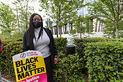 Marsha de Cordova, a British Member of Parliament for Battersea joined hundreds of people to hold placards and take a knee in front of the US Embassy in South London, Sunday, Jun 7, 2020, during a rally to protest against the killing of George Floyd by police officers in Minneapolis, USA. Floyd, a black man, died after he was restrained by Minneapolis police while in custody on May 25 in Minnesota. (Photo/ Vudi Xhymshiti)