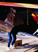 Debbie Buoy of C & F Log lifing mail for logging camp just brought in on Temsco Airlines' Cessna 185, Nichin Cove, Tuxecan Island, Southeast Alaska.