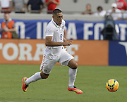 JACKSONVILLE, FL - JUNE 07:  Foward Clint Dempsey #8 of the United States dribbles during the international friendly match against Nigeria at EverBank Field on June 7, 2014 in Jacksonville, Florida.  (Photo by Mike Zarrilli/Getty Images)