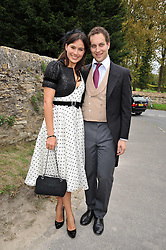 LORD FREDDIE WINDSOR and SOPHIE WINKLEMAN at the wedding of Lohralee Stutz and the Hon.William Astor at St.Augustine's Church, East Hendred, Oxfordshire on 5th September 2009.