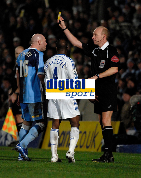 Photo: Richard Lane.<br />Wycombe Wanderers v Chelsea. Carling Cup, Semi Final 1st Leg. 10/01/2007. <br />Chelsea's Claude Makelele and Wycombe's Tommy Mooney are booked by referee, Steve Bennett.