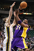 Los Angeles Lakers shooting guard Kobe Bryant (24) attempts to score as he is pressured by Utah Jazz shooting guard Gordon Hayward (20) during the first half of an NBA basketball game, Saturday, Feb. 4, 2012, in Salt Lake City. (AP Photo/Colin E Braley).