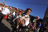 Bolivia. Tarija. Festa di San Roque..Doña Ana Coca once sang and played the guitar, she would like to retake a career, taht's why wait for the arrival of the saint holding up a statue of the local patron saint of musicians.