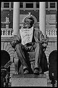 """Madison, WI - March 1970. On March 15, 1970, the University of Wisconsin - Madison Teaching Assistants' Association voted to strike, and the campus was filled with picket lines as well as demonstrations of related and other issues. The strike lasted until early April, when the Association and University came to an agreement. The statue of Abraham Lincoln in front of Bascom Hall wears a blindfold and a sign that reads """"Student in support of TA[A]"""""""