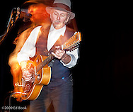 Roy Rogers - blues slide guitarist in concert with motion blur at the Triple Door Dinner Theater, Seattle, WA, USA