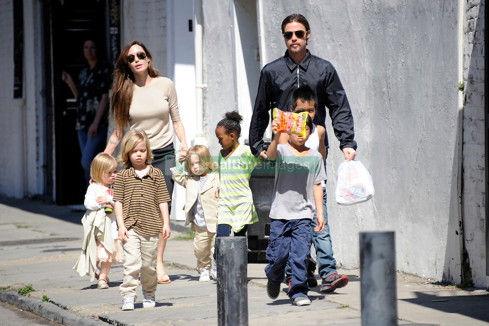Brad Pitt and Angelina Jolie go for a walk with their six children Maddox, Pax, Zahara, Shiloh, Knox, and Vivienne in their neighborhood in New Orleans, LA, USA on March 20, 2011. Photo by Mehdi Taamallah/ABACAPRESS.COM    268006_005 New Orleans Nouvelle Orleans Etats-Unis United States