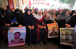 May 13, 2019 - Gaza City, Gaza Strip, Palestinian Territory - Palestinians take part in a protest to show solidarity with Palestinian Prisoners held in Israeli jails, in front of Red Cross office, in Gaza city, on May 13, 2019  (Credit Image: © Mahmoud Ajjour/APA Images via ZUMA Wire)