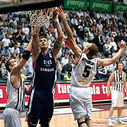 Besiktas's Muratcan GULER (R) and Efes Pilsen's Mario KASUN (C) during their Turkish Basketball league Play Off semi final second leg match Besiktas between Efes Pilsen at the BJK Akatlar Arena in Istanbul Turkey on Wednesday 12 May 2010. Photo by Aykut AKICI/TURKPIX