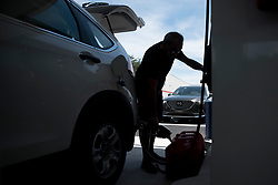 September 5, 2017 - West Palm Beach, Florida, U.S. - HUGO GUANCO of Lake Worth fills three spare fuel tanks at the Lantana Road Costco in Lake Worth, Fla., on Tuesday. ''Sometimes it happens, sometimes it doesn't,'' he said, referring to the possibility of hurricane Irma. ''Best to be prepared.'' Hundreds of residents waited in long lines to fill car tanks and spares with gas. (Credit Image: © Andres Leiva/The Palm Beach Post via ZUMA Wire)