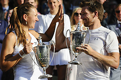LONDON, July 16, 2018  Alexander Peya (R) of Austria and Nicole Melichar of the United States show their trophies after winning the mixed doubles final match against Jamie Murray of Britain and Victoria Azarenka of Belarus at the Wimbledon Championships 2018 in London, Britain, on July 15, 2018. Alexander Peya and Nicole Melichar won 2-0 and claimed the champion. (Credit Image: © Stephen Chung/Xinhua via ZUMA Wire)