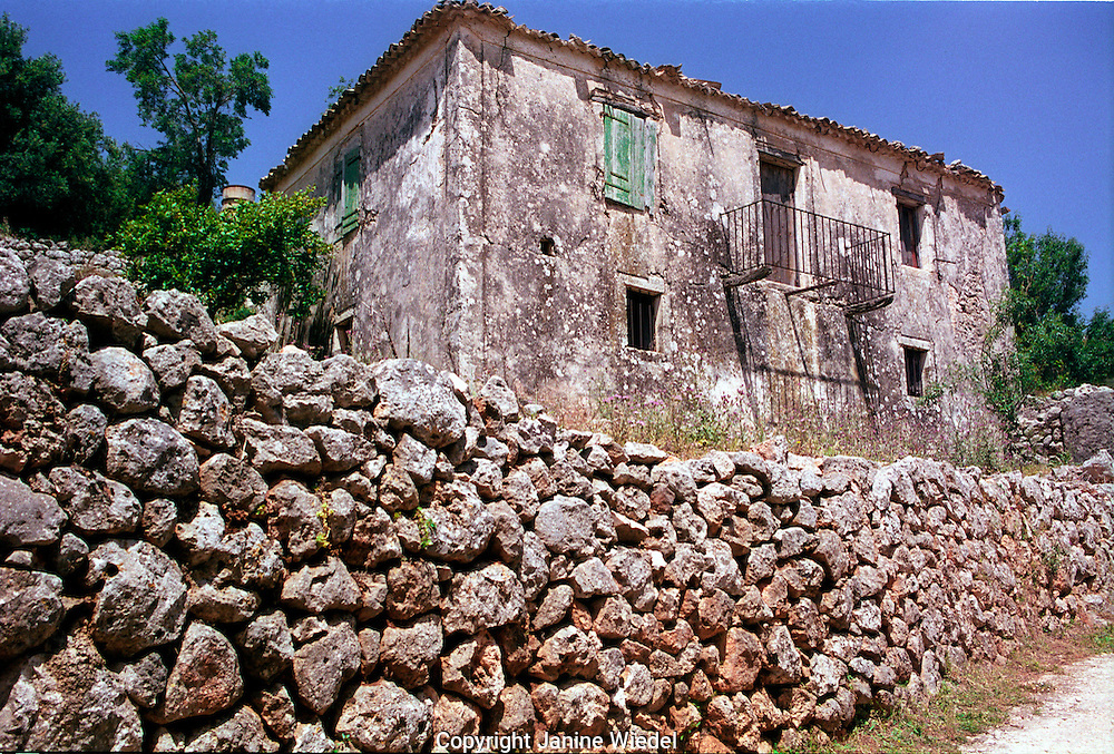 Old stone house with stonewall on Kefalonia.