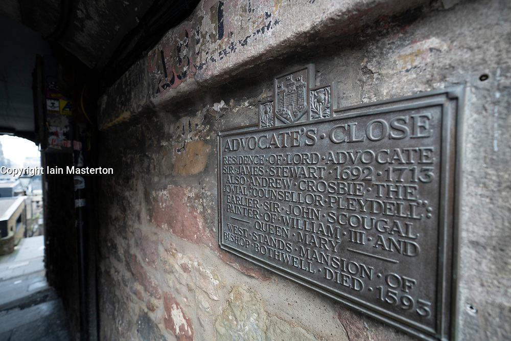 Detail of plaque on wall of Advocate's Close in Edinburgh Old Town, Scotland UK