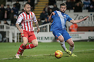 Matthew Bates (Hartlepool United) goes to get to the ball ahead of Keith Keane (on loan from Cambridge United) (Stevenage) during the Sky Bet League 2 match between Hartlepool United and Stevenage at Victoria Park, Hartlepool, England on 9 February 2016. Photo by Mark P Doherty.