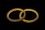 Bronze Age Hattian gold bracelet  from a possible Bronze Age Royal grave (2500 BC to 2250 BC) - Alacahoyuk - Museum of Anatolian Civilisations, Ankara, Turkey. Against a black background .<br /> <br /> If you prefer to buy from our ALAMY PHOTO LIBRARY  Collection visit : https://www.alamy.com/portfolio/paul-williams-funkystock/royal-tombs-alaca-hoyuk-bronze-age.html (TIP refine search by adding background colour in the LOWER search box)<br /> <br /> Visit our ANCIENT WORLD PHOTO COLLECTIONS for more photos to download or buy as wall art prints https://funkystock.photoshelter.com/gallery-collection/Ancient-World-Art-Antiquities-Historic-Sites-Pictures-Images-of/C00006u26yqSkDOM