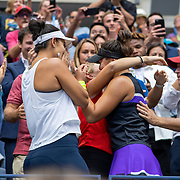 2019 US Open Tennis Tournament- Day Thirteen.    Bianca Andreescu of Canada hugs her team after her victory against Serena Williams of the United States in the Women's Singles Final on Arthur Ashe Stadium during the 2019 US Open Tennis Tournament at the USTA Billie Jean King National Tennis Center on September 7th, 2019 in Flushing, Queens, New York City.  (Photo by Tim Clayton/Corbis via Getty Images)
