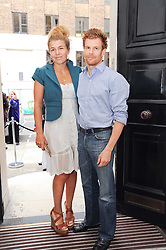 TOM & AMBER AIKENS at a party to celebrate the launch of Page One an online guide to London's 100 most rewarding restaurants held at the Halcyon Gallery, Bruton Street, London on 7th July 2010.