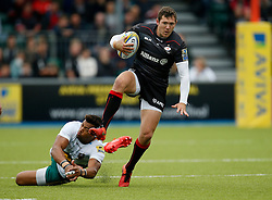 Saracens' Alex Goode and Northampton Saints' Luther Burrell during the Aviva Premiership match at Allianz Park, Barnet.