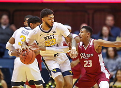 Nov 28, 2018; Morgantown, WV, USA; West Virginia Mountaineers forward Esa Ahmad (23) dribbles while defended by Rider Broncs guard Stevie Jordan (23) during the first half at WVU Coliseum. Mandatory Credit: Ben Queen-USA TODAY Sports
