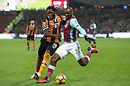 Angelo Ogbonna Obinze of West Ham United and Dieumerci Mbokani of Hull City compete for the ball. Premier league match, West Ham Utd v Hull city at the London Stadium, Queen Elizabeth Olympic Park in London on Saturday 17th December 2016.<br /> pic by John Patrick Fletcher, Andrew Orchard sports photography.