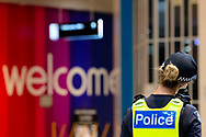 MELBOURNE, VIC - SEPTEMBER 20: A police officer stands guard near a welcome sign in the Chadstone Shopping Centre after a small protest was held during a series of pop up Freedom protests on September 20, 2020 in Melbourne, Australia. Freedom protests are being held in Melbourne every Saturday and Sunday in response to the governments COVID-19 restrictions and continuing removal of liberties despite new cases being on the decline. Victoria recorded a further 14 new cases overnight along with 7 deaths. (Photo by Dave Hewison/Speed Media)