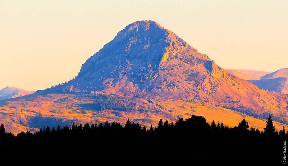 THE ICON   Geologically mysterious Haystack Butte – an icon of prairies of Rocky Mountain Front. And reliable local weather indicator on whether a storm spilled from the mountains behind it already or do we still have time to make it home?