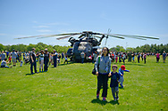 East Meadow, New York, USA. May 25, 2019. U.S. Navy MH53-E helicopter has crowds looking at it inside and outside, at the U.S. Navy hosted aviation event, as part of Fleet Week, on Memorial Day Weekend at Eisenhower Park on Long Island. Visitors could speak with members of Command HM14, Helicopter Mine countermeasures Squadron 14, which has a Korea deployment mine sweeping. MH-53E does long range minesweeping, AKA Airborne Mine Countermeasures (AMCM) missions, and carries heavy loads and transports and picks up things for the Navy.