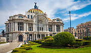 """The Palacio de Bellas Artes (Palace of Fine Arts) is a prominent cultural center in Mexico City. It has hosted some of the most notable events in music, dance, theatre, opera and literature and has held important exhibitions of painting, sculpture and photography. Consequently, the Palacio de Bellas Artes has been called the """"Cathedral of Art in Mexico"""". The building is located on the western side of the historic center of Mexico City next to the Alameda Central park.<br /> <br /> The first National Theater of Mexico was built in the late 19th century, but it was soon decided to tear this down in favor of a more opulent building in time for Centennial of the Mexican War of Independence in 1910. The initial design and construction was undertaken by Italian architect Adamo Boari in 1904, but complications arising from the soft subsoil and the political problem both before and during the Mexican Revolution, hindered then stopped construction completely by 1913. Construction began again in 1932 under Mexican architect Federico Mariscal and was completed in 1934. The exterior of the building is primarily Neoclassical and Art Nouveau and the interior is primarily Art Deco. The building is best known for its murals by Diego Rivera, Siqueiros and others, as well as the many exhibitions and theatrical performances its hosts, including the Ballet Folklórico de México."""