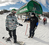 A cold day at work for lift attendant Kyle Nelson checking in skiers and riders as they load the Panorama lift at Gunstock Mountain Resort Wednesday afternoon.   (Karen Bobotas/for the Laconia Daily Sun)
