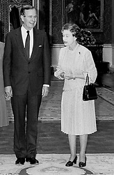 File photo dated 01/06/89 of the then US President George Bush and Queen Elizabeth II in the Picture Room at Buckingham Palace, London.