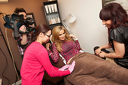 """Maria gets a Vajazzle on her hip at Red Earth..Filming of """"Ma Way"""", Maria Fowler""""s guide to Perth..© Michael Schofield."""