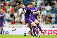 Real Madrid's Lucas Vazquez (l) and ACF Fiorentina's Jordan Veretout (c) and Rafik Zekhnini during Santiago Bernabeu Trophy. August 23,2017. (ALTERPHOTOS/Acero)