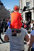 Father carrying his daughter on his shoulders along Regent Street in central London, UK.