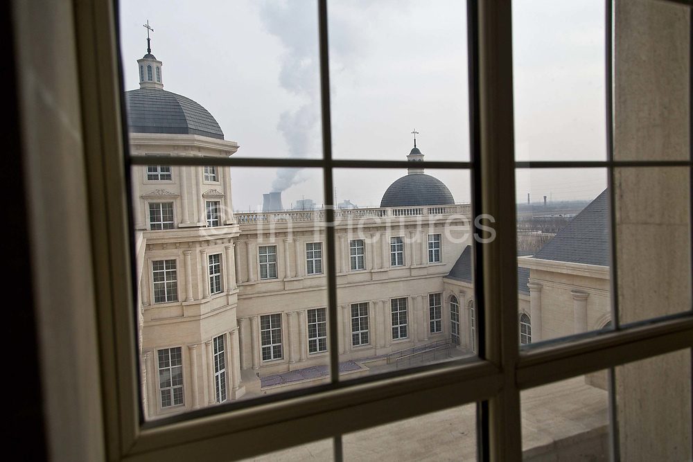 A view out of a window of the Chateau Changyu Moser XV, which will be open to the public next May, in Yinchuan, Ningxia Hui Autonomous Region, China on 21 December  2012.  With its dry climates and ample sunshine, and encouraged by the huge boom in Chinese consumer's demand for wine, Ningxia is quickly becoming one of the biggest wine producing regions in China.