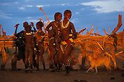 Sisters and female cousins of a young Hamar man who will to perform the bull jump, a ritual making him eligible for marriage, show their devotion to him by dancing and singing about their excitement about his forth-coming jump in South Omo, Ethiopia. The 40,000-strong, cattle-herding Hamar are among the largest of the 20 or so ethnic groups which inhabit the culturally diverse Omo region in south-west Ethiopia.