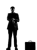 silhouette caucasian business man  waiting checking the time full length on studio isolated white background