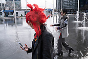 Girls dressed up for a day out in their Cosplay guises Nao Egokoro with red hair and Reko Yabusame, from the video game Your turn to die on 14th March 2020 in Birmingham, United Kingdom. Cosplay or costume play, is a performance art in which participants called cosplayers wear costumes and fashion accessories to represent a specific character. Cosplayers often interact to create a subculture, and a broader use of the term applies to any costumed role-playing in venues apart from the stage. Favorite sources include anime, cartoons, comic books, manga, television series, and video games.