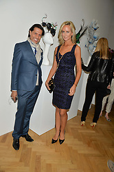 ALEXANDER BARANI and LADY VICTORIA HERVEY at a private view and auction of millinery organised by author, philanthropist and hat collector Eva Lanska in aid of Women for Women International held at Pace, Burlington Gardens, London on 10th June 2015.