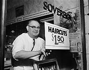 Y-530624A.  Frank Penner, barber, Sovereign Hotel shop, June 24, 1953