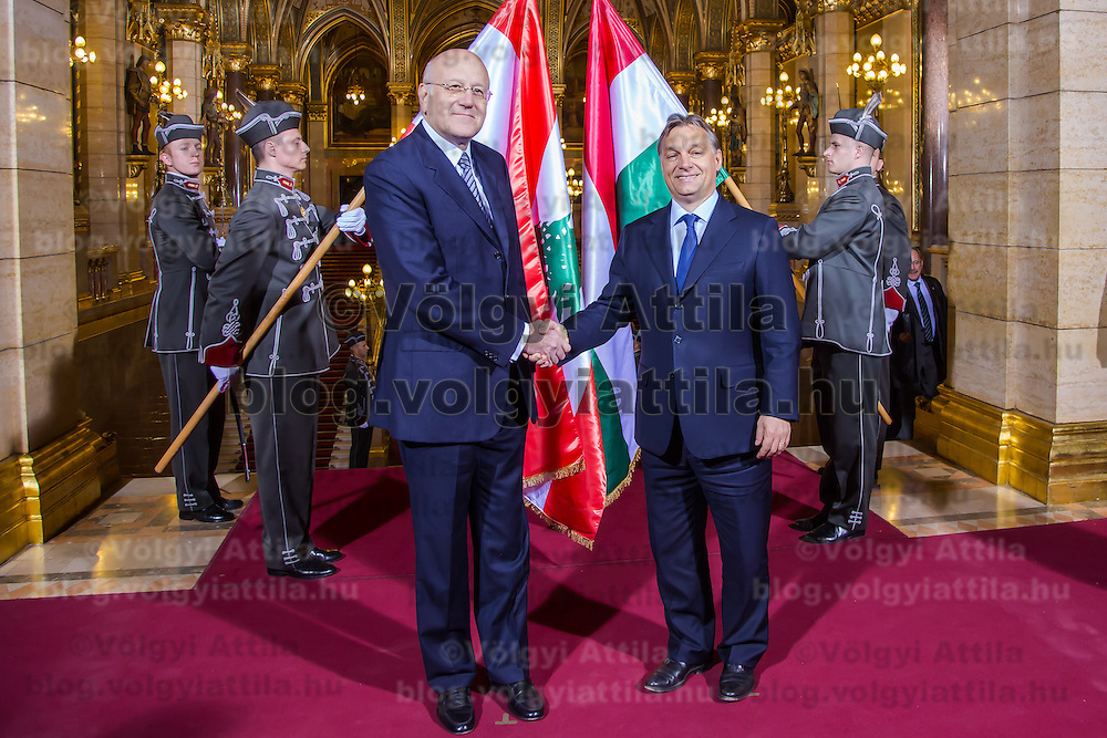 Viktor Orban (R) prime minister of Hungary shakes hands with his counterpart Najib Azmi Mikat (L) prime minister of Lebanon during a welcoming ceremony in Budapest, Hungary on November 06, 2012. ATTILA VOLGYI