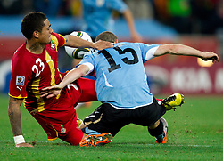 Kevin Prince Boateng of Ghana vs Diego Perez of Uruguay during the overtime at 2010 FIFA World Cup South Africa Quarter Finals football match between Uruguay and Ghana on July 02, 2010 at Soccer City Stadium in Sowetto, suburb of Johannesburg. Uruguay defeated Ghana after penalty shots. (Photo by Vid Ponikvar / Sportida)